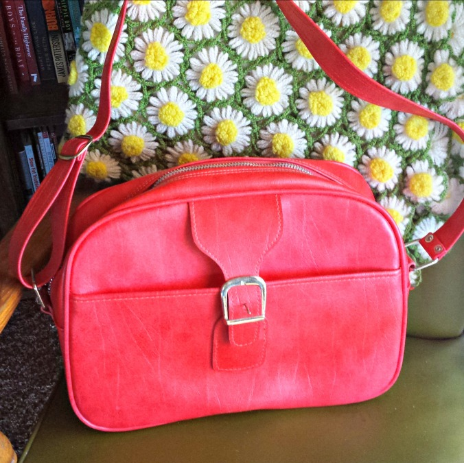Cherry red vinyl 1960s carry-on bag.