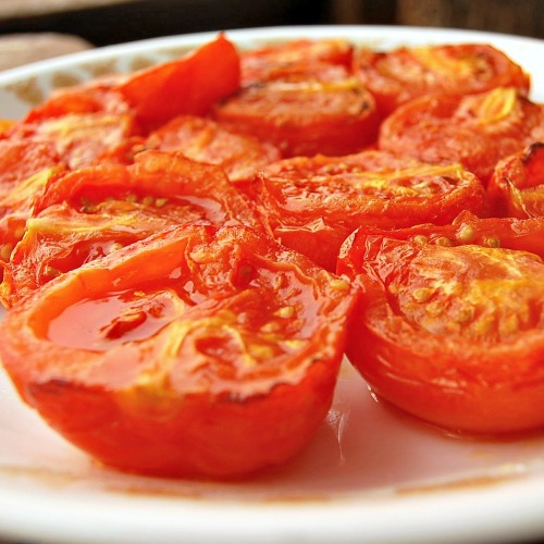 Oven-roasted  tomatoes--marinate in olive oil and lime juice to bring out the natural flavors. Try these with buttered toast and a little cheese for lunch!